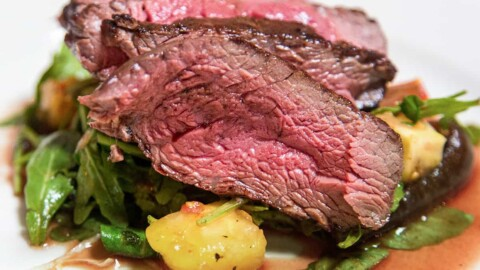 Air fryer roast beef on a white plate