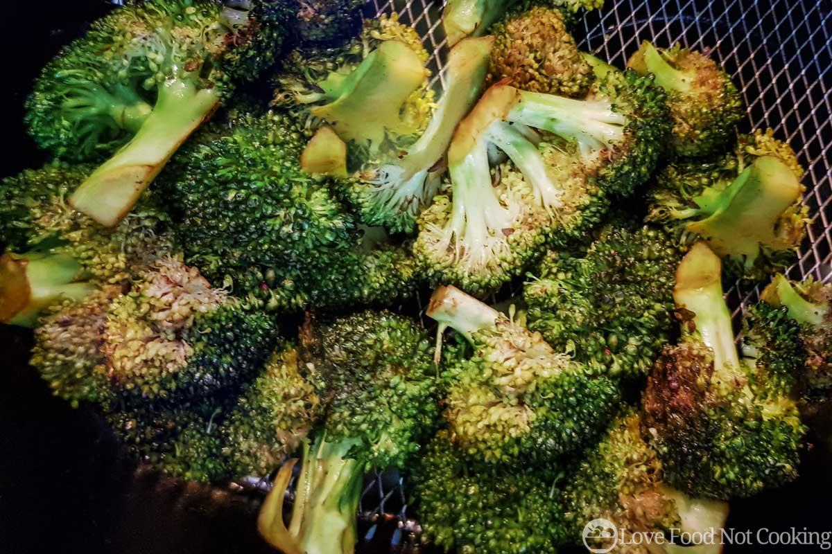 Roasted broccoli in air fryer basket