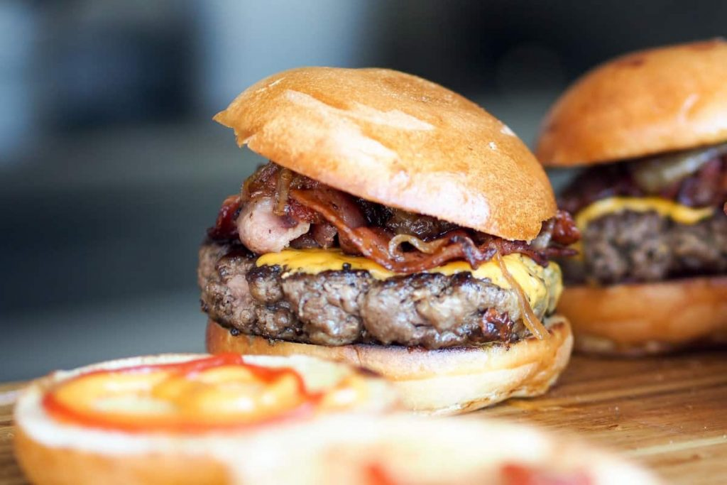 Air fryer hamburgers topped with cheese, bacon and mushrooms.
