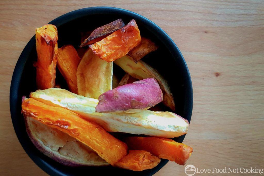 Air fryer roast vegetables in a black bowl