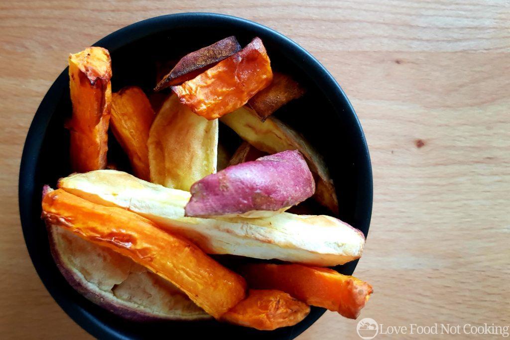 Air fried roast vegetables in a black bowl
