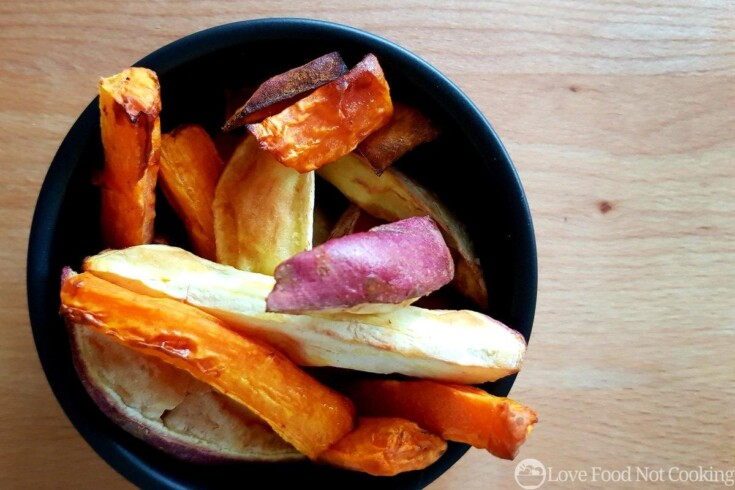 Air fried roast vegetables in a black bowl