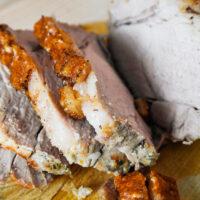 Air fryer roast pork sliced on a wooden board