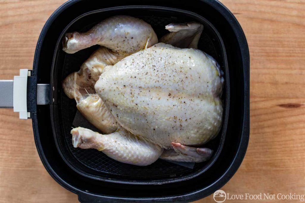 Whole chicken in the air fryer basket
