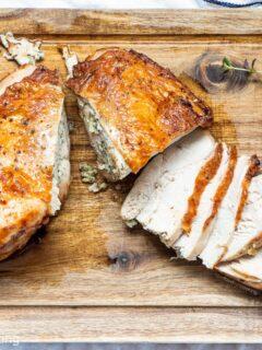 Air fryer turkey breast sliced on a wooden board