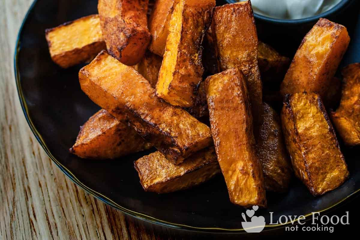 Air fryer pumpkin fries on a black plate