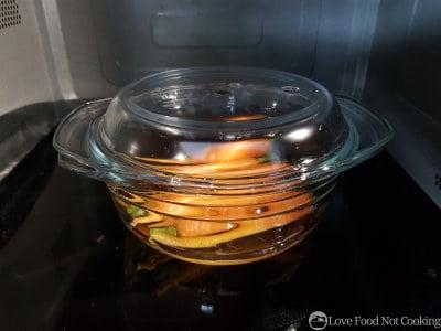 Carrots in a glass bowl in a microwave