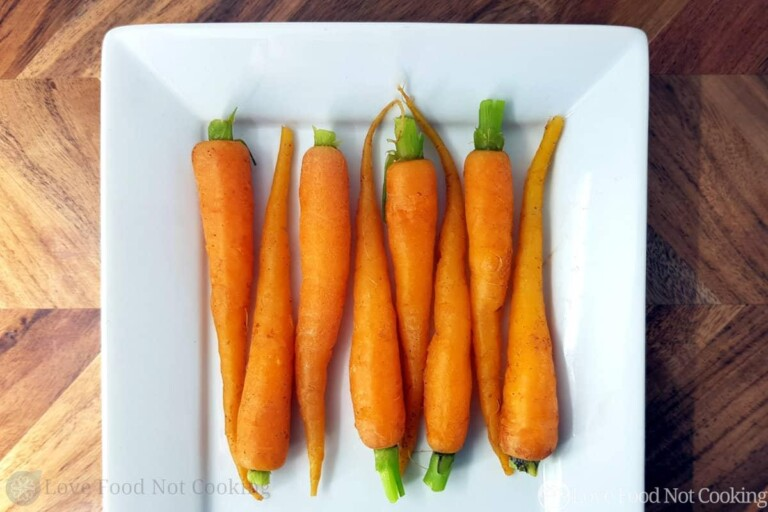 Microwave Steamed Carrots on a square white plate.