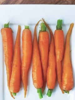 Microwave Steamed Carrots on a white plate