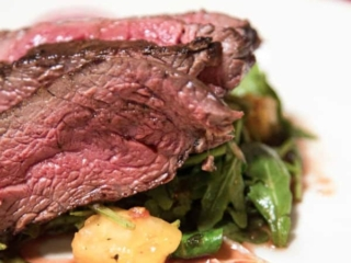 Air fryer roast beef with potatoes and spinach on a white plate