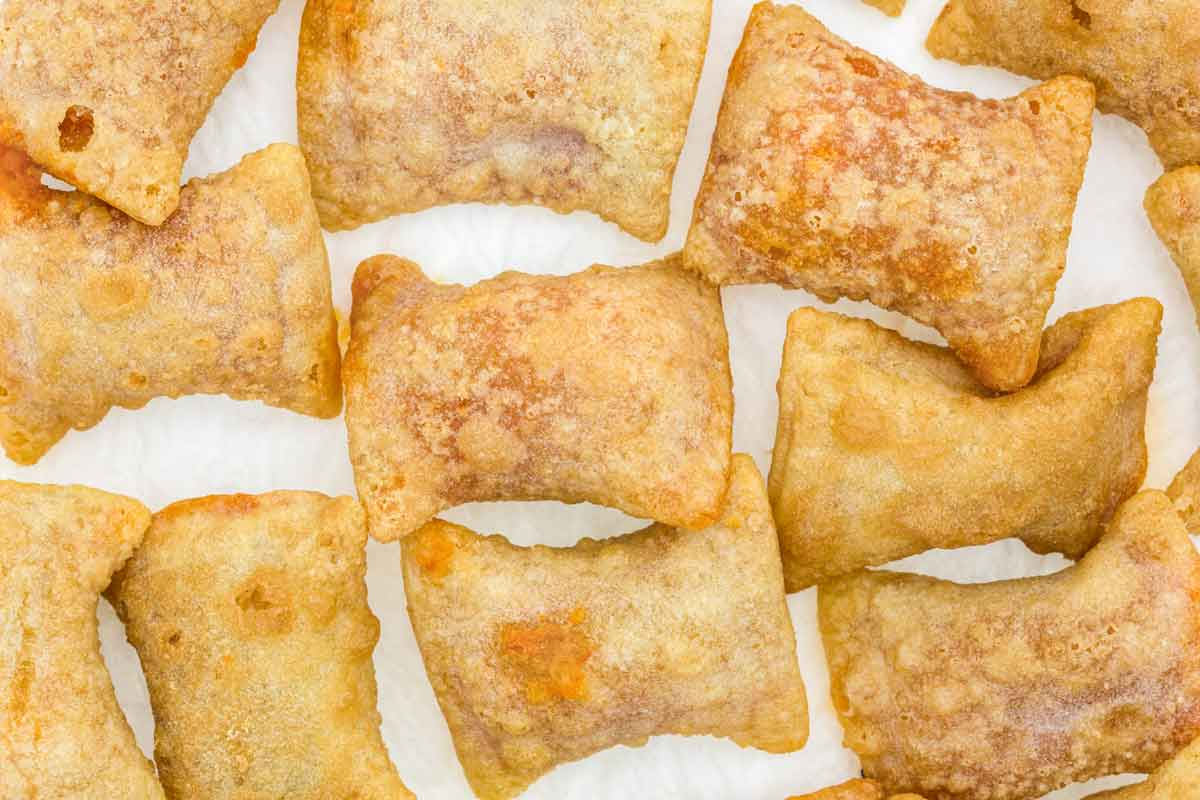 Air fried pizza rolls on a white background