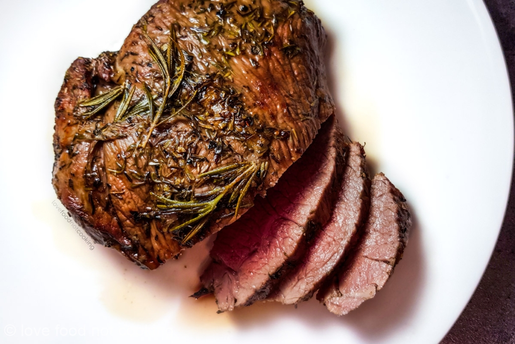 Air fryer roast lamb on a white plate