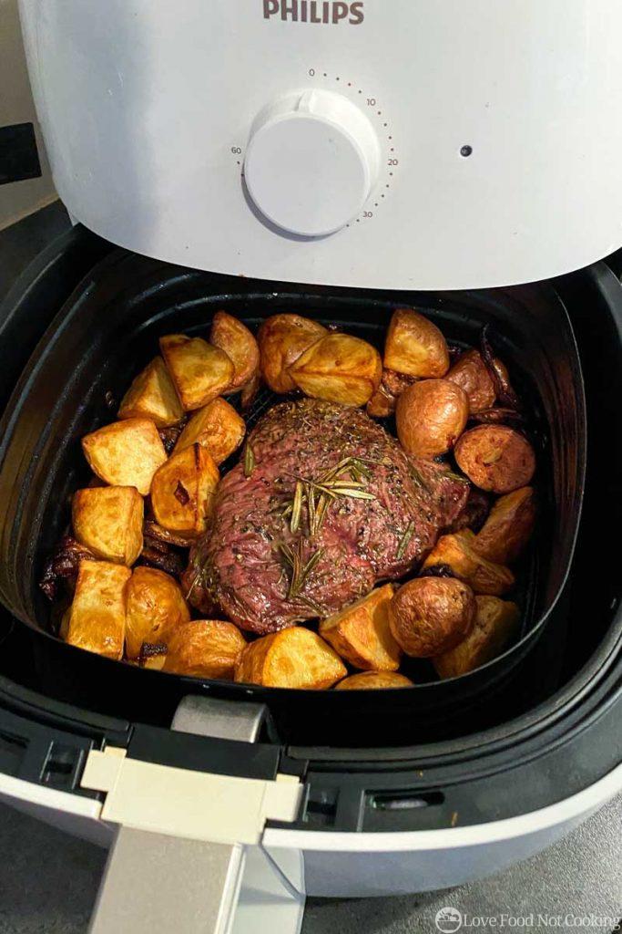 Roast lamb and potatoes in air fryer basket