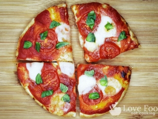 Air fryer pizza on a wooden board.