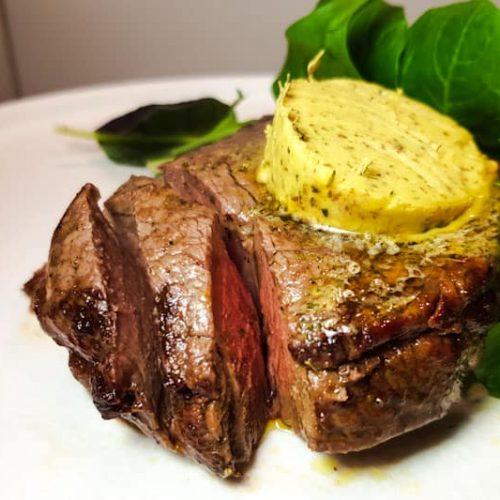 Air fryer steak with herb butter.
