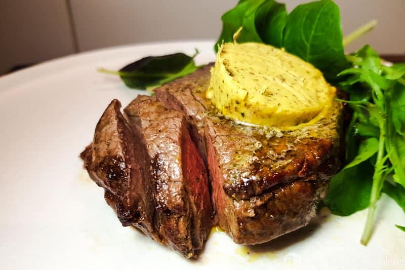 Air fryer steak with herb butter.