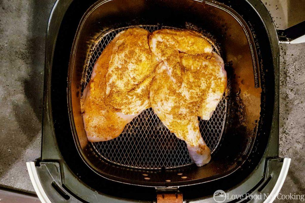 Half chicken in air fryer basket