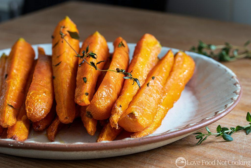 Air fryer carrots on white plate