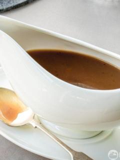 Homemade gravy in a white gravy boat
