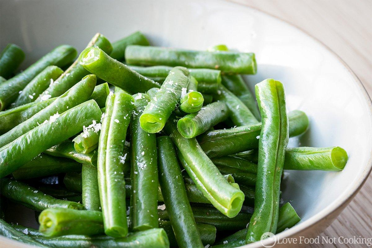 Microwaved fresh green beans in a bowl