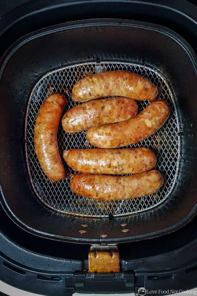 Air fried sausages in air fryer basket