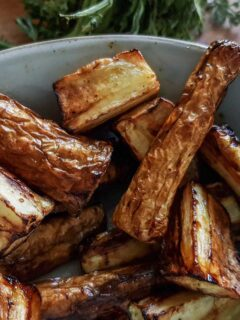 Air fried parsnips in a blue bowl