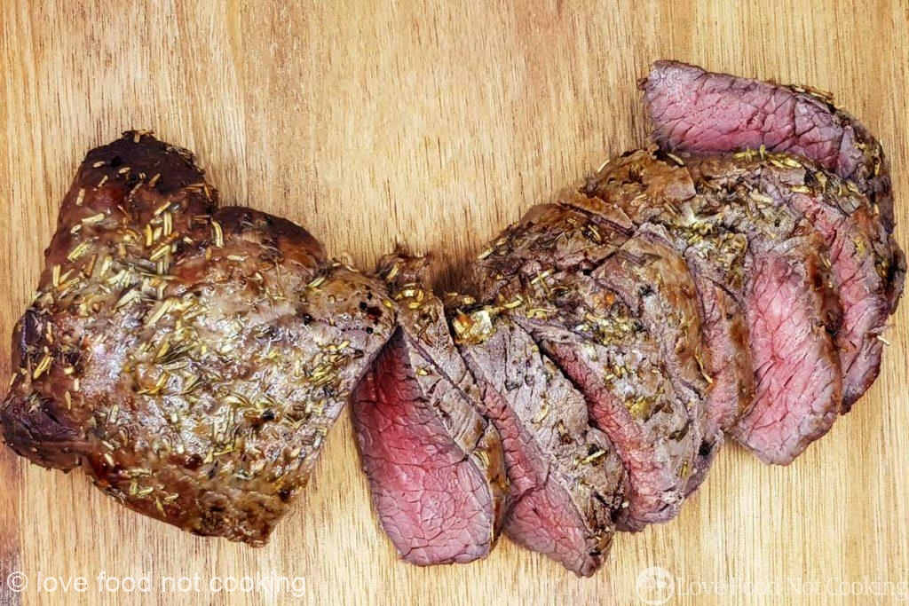 Air Fryer Beef Tenderloin on a wooden carving board