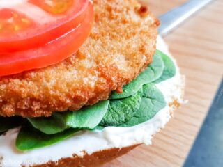 Air fryer frozen chicken patty on a bun with tomato and mayo