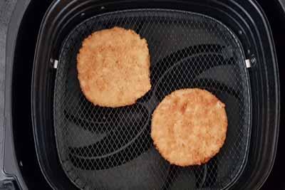 Frozen chicken patties in air fryer basket