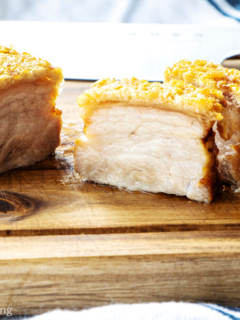 Crispy air fried pork belly on a wooden board