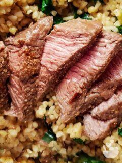Air fried lamb steaks on a bed of couscous.
