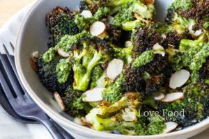 Air fried broccoli in a grey bowl.