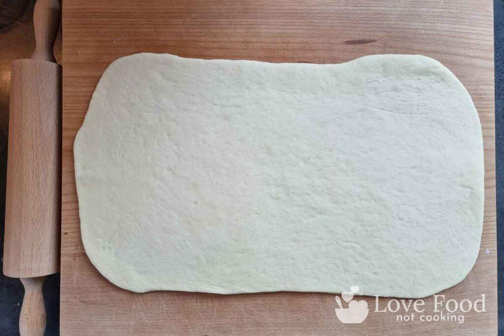Dough rolled into a rectangle shape.