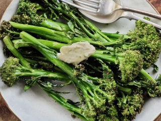 Air fryer broccolini on a white plate.
