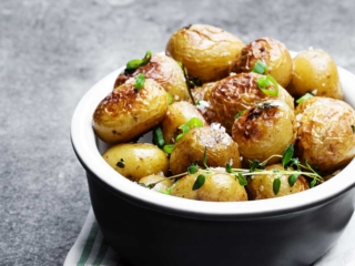 air fried baby potatoes in a black bowl.