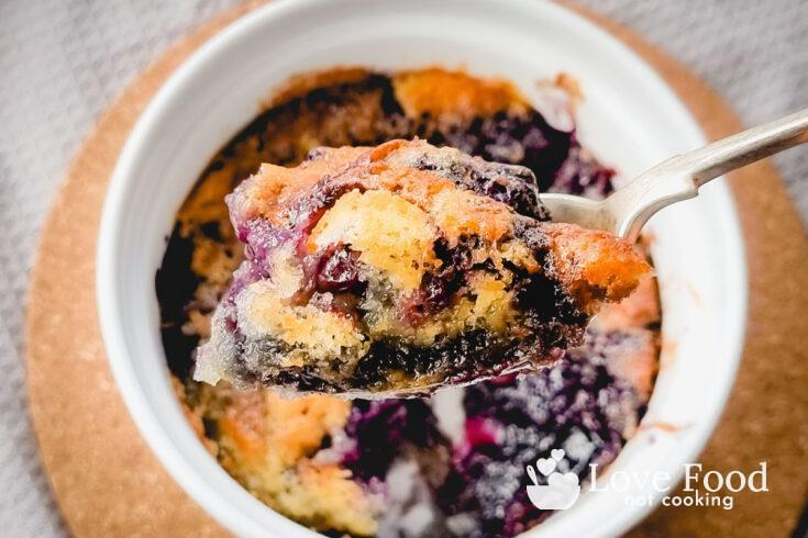 A spoonful of air fryer blueberry cobbler.