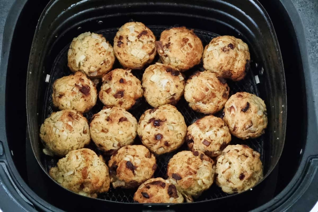 Cooked stuffing in air fryer basket.