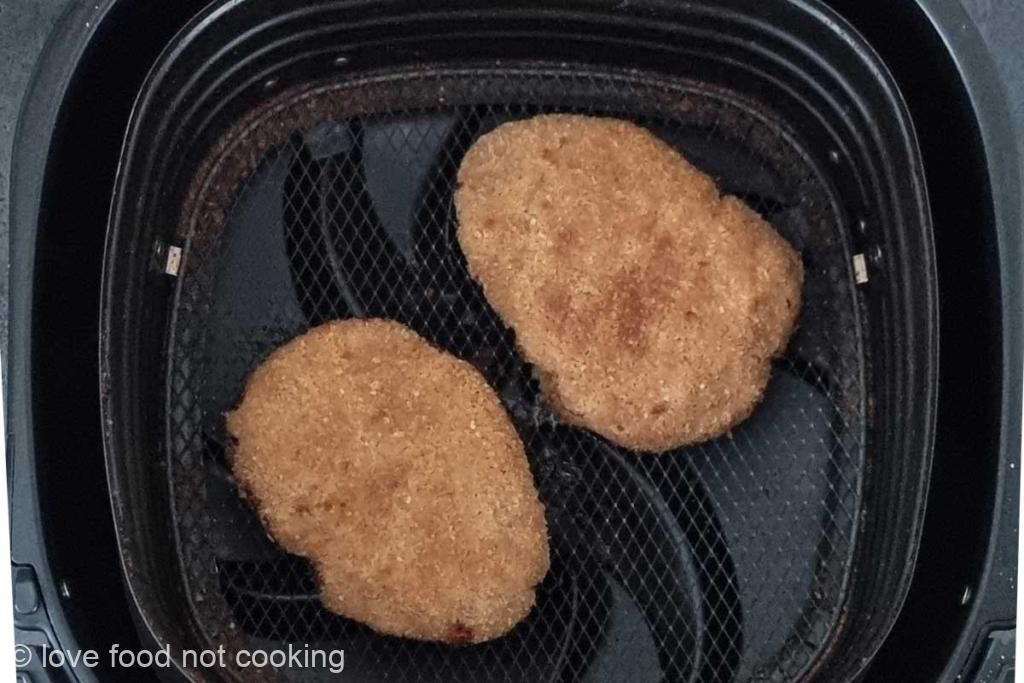 Chicken fried steaks in air fryer basket/