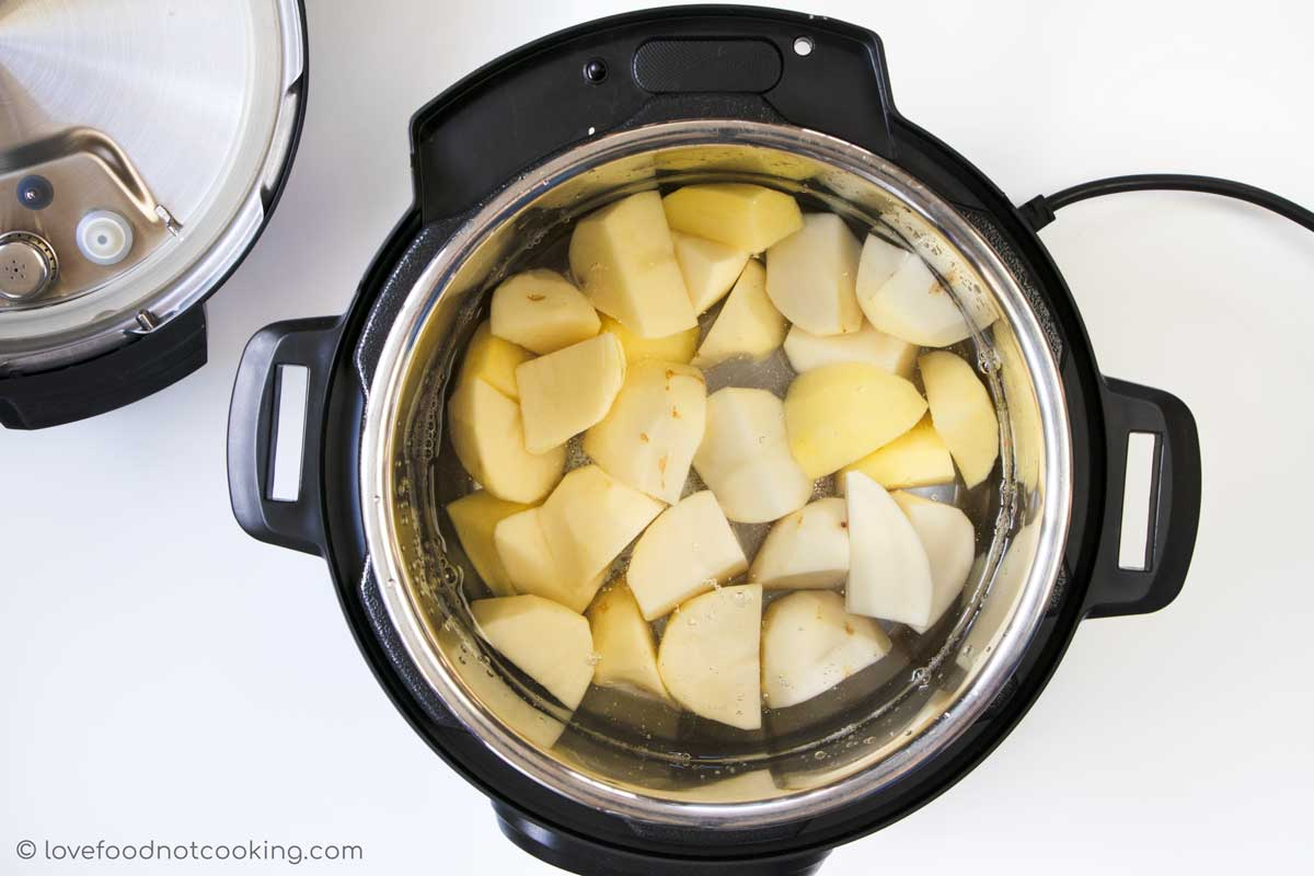 Cut potatoes in an Instant Pot with water.